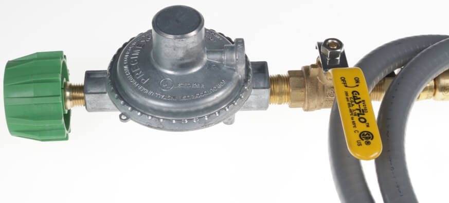 Green Acme Safety Tank Fitting on Low Pressure Regulator
